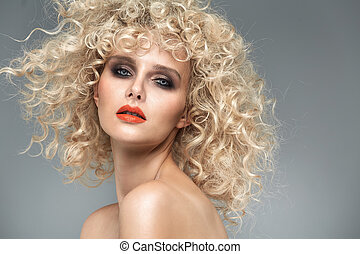 Beautiful blond lady with gorgeous curly coiffure -...