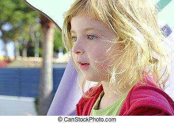 beautiful blond little girl children portrait in park
