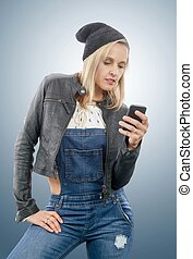 blond middle-aged woman with phone