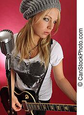 Beautiful blond playing electric guitar
