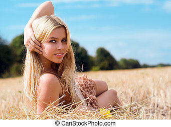 beautiful blond - Portrait of a beautiful blond woman in the...