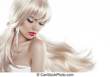 Beautiful blond with long hair. Makeup. Sensual woman with blowi