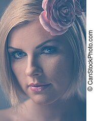Beautiful blond with rose