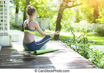 Beautiful blond woman doing yoga