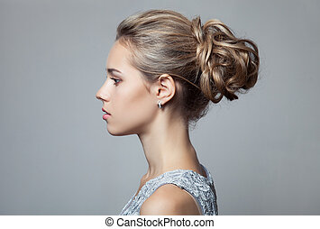Beautiful Blond Woman. Hairstyle and Make-up.