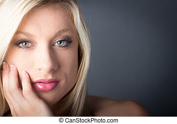 Beautiful Blond Woman hand on her cheek