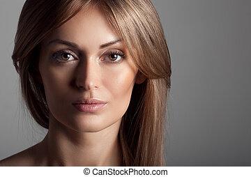 Beautiful Blond Woman. Healthy Long Hair. Make Up.