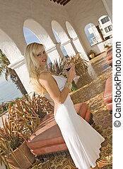 Beautiful Blond woman holding a glass of Wine