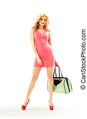 Beautiful blond woman holding a handbag