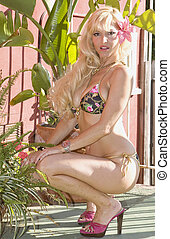 Beautiful Blond Woman in Bikini with Plants