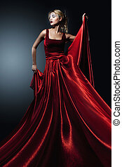 woman in elegant red dress. Profess