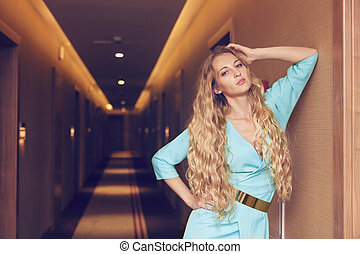 Beautiful blond woman in long dres