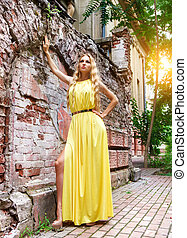 Beautiful blond woman in long dress