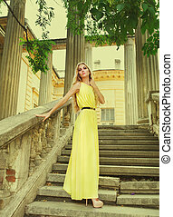 Beautiful blond woman in long yellow dress