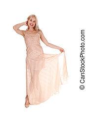 Beautiful blond woman in pink dress