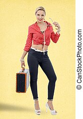 beautiful blond woman in retro style with suitcase