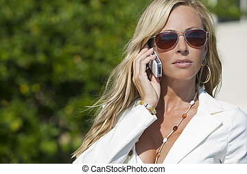 Beautiful Blond Woman In Sunglasses Talking On Cell Phone