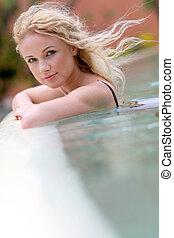 Beautiful blond woman in swimming pool