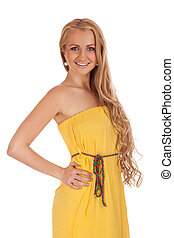 Beautiful blond woman in yellow dress