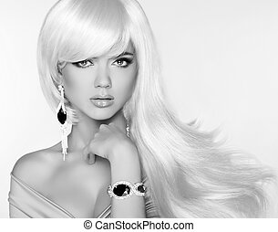 Beautiful blond woman model with long wavy hair. Luxury Jewelry.