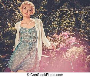 Beautiful blond woman near retro roller