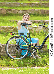 Beautiful Blond Woman Outdoors Enjoying Nature with Bicycle