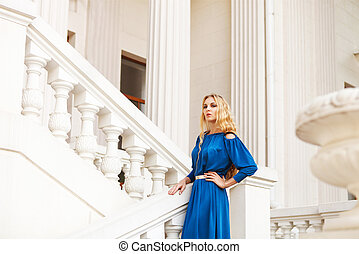 Beautiful blond woman outdoors on the stairs