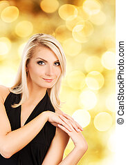 Beautiful blond woman over abstract background
