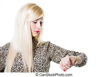 Beautiful blond woman portrait checking wrist watch