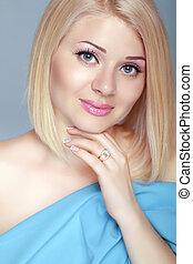 Beautiful blond woman portrait, makeup, skin care, bob hairstyle. Studio photo