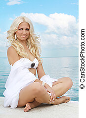 Beautiful blond woman relaxing at the seaside
