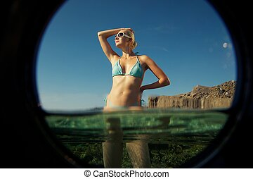 Beautiful blond woman relaxing in the sea