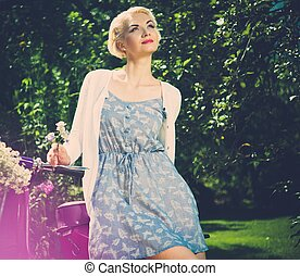 Beautiful blond woman sitting on a retro roller