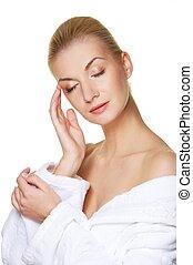 Beautiful blond woman touching her face