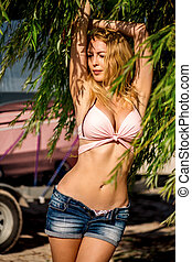 Beautiful blond woman wearing jeans