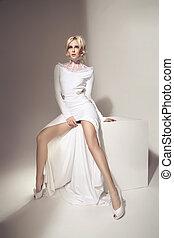 Beautiful blond woman wearing long gown