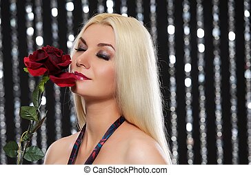 Beautiful blond woman with a rose