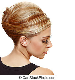 beautiful blond woman with false long eyelashes wearing hair in a classic french roll updo style