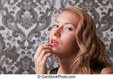 Beautiful blond woman with finger on her lips