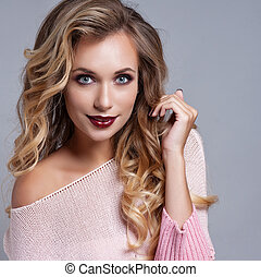 Beautiful blond woman with long curly hair