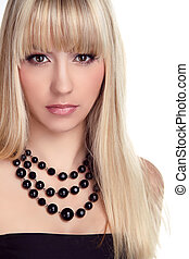Beautiful blond woman with long hair styling isolated on white background. Fashion and Jewelry