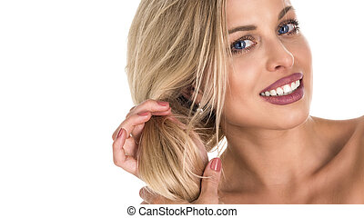 beautiful blond woman with long hair touching her hair on whie background. Perfect smile. Copy space