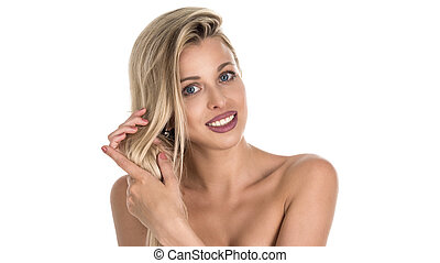 beautiful blond woman with long hair touching her hair on whie background. Perfect smile. Stomatology concept