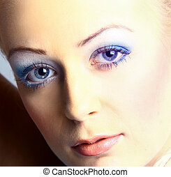 Beautiful blond woman with long lashes