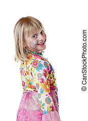Beautiful blond young girl in carnival costume smiles happy