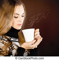 Beautiful blond young woman drinking coffee