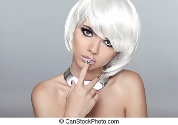 Beautiful blond young woman with polish finger. Makeup. Manicure