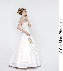 Beautiful blonde bride wearing wedding dress
