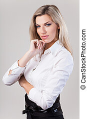 Beautiful blonde business woman in white shirt