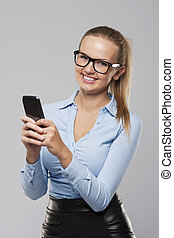Beautiful blonde businesswoman with mobile phone